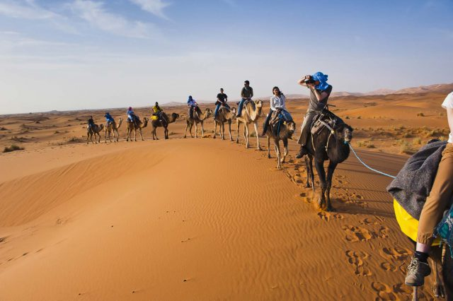 Morocco, Camel ride in Erg Chebbi Sahara Desert, Merzouga, by travel photographer Matthew Williams-Ellis